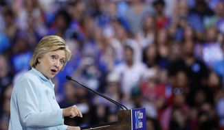 Democratic presidential candidate Hillary Clinton speaks during a campaign rally with Sen. Tim Kaine, D-Va., at Florida International University Panther Arena in Miami, Saturday, July 23, 2016. Clinton has chosen Kaine to be her running mate. (AP Photo/Mary Altaffer)
