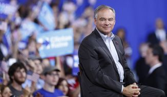 Sen. Tim Kaine, D-Va., listens as Democratic presidential candidate Hillary Clinton speaks during a campaign rally at Florida International University Panther Arena in Miami, Saturday, July 23, 2016. Clinton has chosen Kaine to be her running mate. (AP Photo/Mary Altaffer)