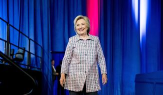 Democratic presidential candidate Hillary Clinton arrives to speak at the 117th National Convention of Veterans of Foreign Wars at the Charlotte Convention Center in Charlotte, Monday, July 25, 2016. (AP Photo/Andrew Harnik)