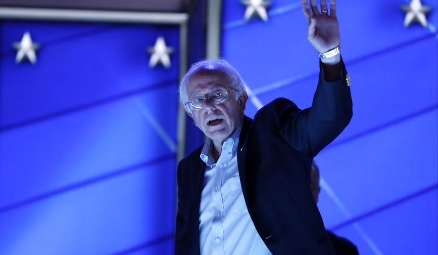 Sen. Bernie Sanders, I-Vt., waves as he walks off the stage after checking out the podium before the start of the first day of the Democratic National Convention in Philadelphia, Monday, July 25, 2016. (AP Photo/Carolyn Kaster)