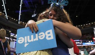 Pennsylvania delegates Amanda McIllmurray and Katherine Sayder cry after Former Democratic Presidential candidate, Sen. Bernie Sanders, I-Vt., spoke to delegations during the first day of the Democratic National Convention in Philadelphia , Monday, July 25, 2016. (AP Photo/Carolyn Kaster)