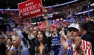 Delegates cheer during the third day session of the Republican National Convention in Cleveland, Wednesday, July 20, 2016. (AP Photo/Mary Altaffer)