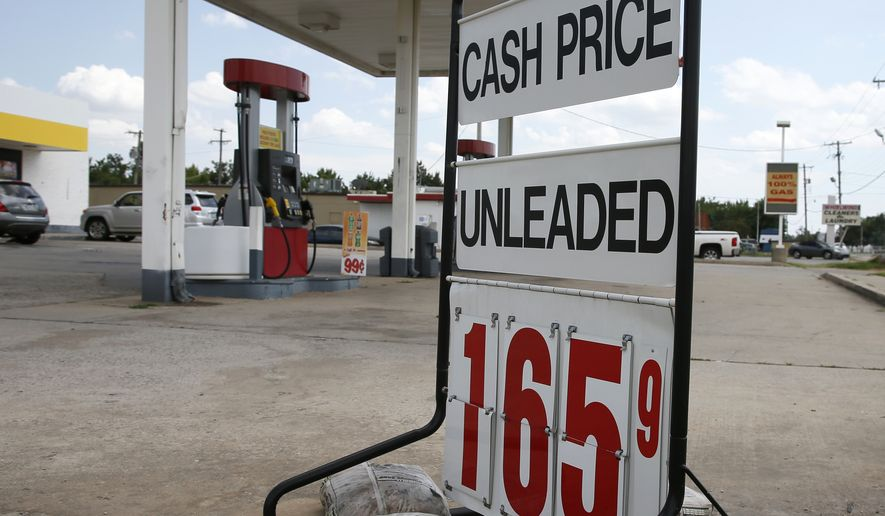 A sign advertising gas prices for cash purchases is pictured in Oklahoma City, Monday, July 25, 2016. Oklahoma motorists are paying some of the lowest gasoline prices in the nation. (AP Photo/Sue Ogrocki)