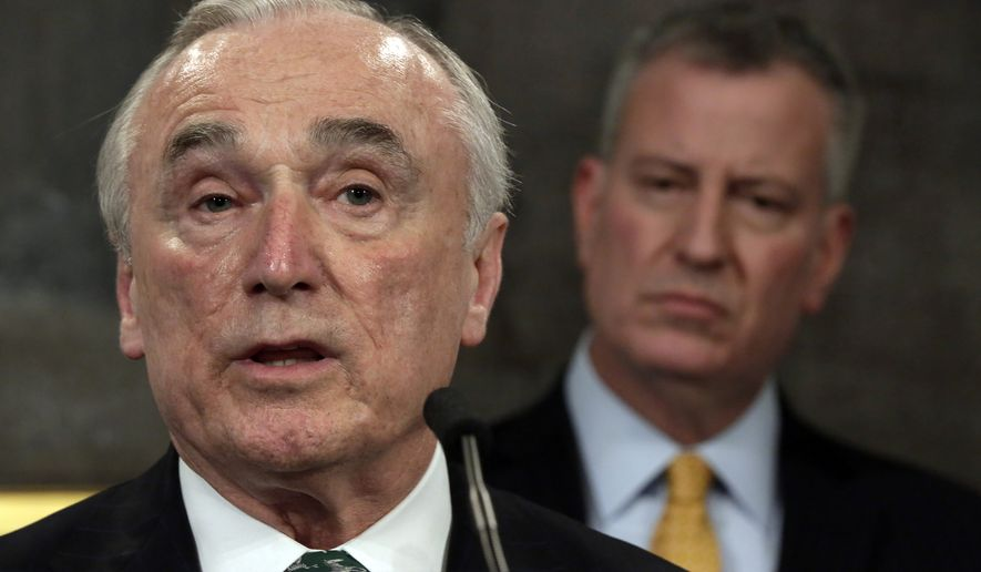 New York City Police Commissioner William Bratton (left) speaks during a news conference in New York's City Hall on Jan. 12, 2016, as New York Mayor Bill de Blasio listens. (Associated Press) **FILE**