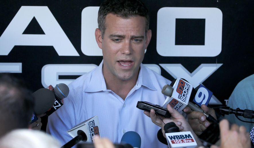 Chicago Cubs president of baseball operations Theo Epstein talks to reporters about acquiring closer Aroldis Chapman from the New York Yankees before a baseball game between the Chicago White Sox and Cubs on Monday, July 25, 2016, in Chicago. (AP Photo/Charles Rex Arbogast)