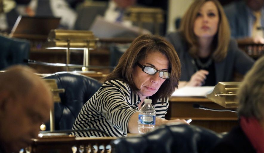 FILE - In this Monday, Jan. 11, 2016, file photo, New Jersey Assemblywoman Pamela R. Lampitt, D- Voorhees, N.J., casts her vote during an Assembly session at the Statehouse, in Trenton, N.J. While New Jersey is making progress toward getting more women involved in politics, analysts and female lawmakers say much more can and should be done to increase the number of women who hold elected office. Only 36 of 120 seats in the state Legislature are held by women. (AP Photo/Mel Evans,file)