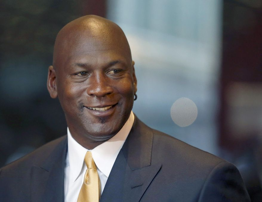 FILE - In this Aug. 21, 2015, file photo, former NBA star and current owner of the Charlotte Hornets, Michael Jordan, smiles at reporters in Chicago. Jordan announced Monday, July 25, 2016,  he's giving $1 million to the Institute for Community-Police Relations and $1 million to the NAACP Legal Defense Fund to help build trust between blacks and law enforcement following several disturbing clashes around the country. (AP Photo/Charles Rex Arbogast, File)