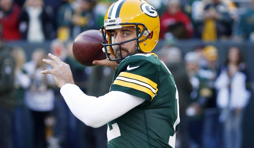 FILE - In this Sunday, Nov. 15, 2015 file photo, Green Bay Packers quarterback Aaron Rodgers warms up before an NFL football game against the Detroit Lions in Green Bay, Wis. Packers coach Mike McCarthy said Monday, July 25, 2016, Rodgers is in great shape as the team starts training camp, and that it's the best shape that he's seen Rodgers in their time together. (AP Photo/Mike Roemer, File)