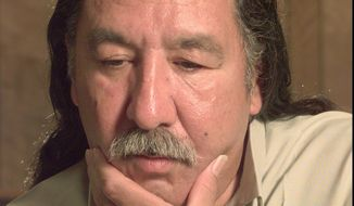 In this April 29, 1999, file photo, American Indian activist Leonard Peltier speaks during an interview at the U.S. Penitentiary at Leavenworth, Kan. The legal team for Peltier is hoping President Barack Obama will pardon him before he leaves office. Peltier is serving two life sentences for the 1975 shooting deaths of two FBI agents during a standoff on South Dakota's Pine Ridge Indian Reservation. (Joe Ledford/The Kansas City Star via AP, File)