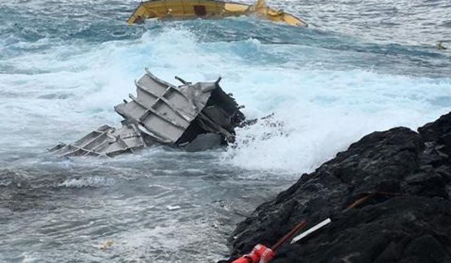 This photo provided by the Hawaii Dept. of Land and Natural Resources shows a portion of a capsized vessel. The first storm of the hurricane season sent Hawaii into hurried preparation mode, but residents got through the weekend without seeing major damage as the storm was downgraded, officials said Monday, July 25, 2016. On the Big Island, which got hit Saturday, the 70-foot vessel apparently broke free of its moorings in rough surf and sank early Sunday, Bill Taylor of the Department of Land and Natural Resources told the West Hawaii Today newspaper. (Jerome Judd/Hawaii Dept. of Land and Natural Resources via AP)