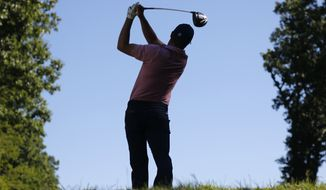 Jordan Spieth watches his tee shot on the third hole during a practice round for the PGA Championship golf tournament at Baltusrol Golf Club in Springfield, N.J., Tuesday, July 26, 2016. (AP Photo/Mike Groll)