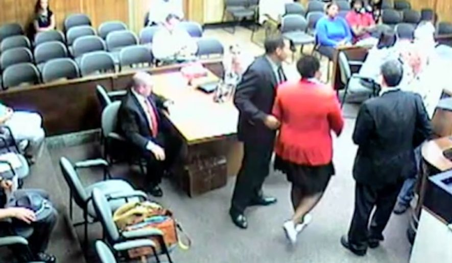 Ohio attorney Andrea Burton is appealing a contempt of court charge after she was taken into custody last week for refusing to take off a Black Lives Matter button. (WKBN)