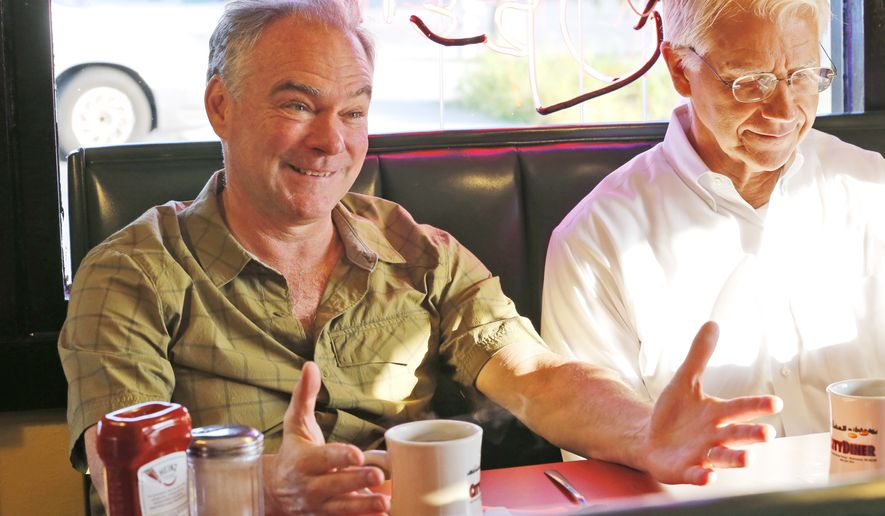 Democratic vice presidential candidate Sen. Tim Kaine, D-Va., left, talks with friends as he has breakfast at a diner in Richmond, Va., Tuesday, July 26, 2016. (AP Photo/Steve Helber)