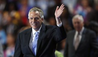 Virginia Gov. Terry McAuliffe takes the stage during the second day of the Democratic National Convention in Philadelphia , Tuesday, July 26, 2016. (AP Photo/Paul Sancya)