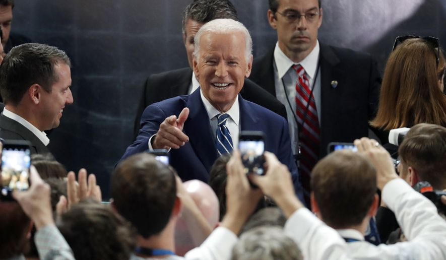 Vice President Joe Biden talks to people as he checks out the stage at Wells Fargo Arena before the start of the second day session of the Democratic National Convention in Philadelphia, Tuesday, July 26, 2016. (AP Photo/Paul Sancya)