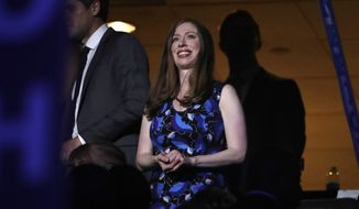 Chelsea Clinton, daughter of former President Bill Clinton, applauds during the second day session of the Democratic National Convention in Philadelphia, Tuesday, July 26, 2016. (AP Photo/Matt Rourke)