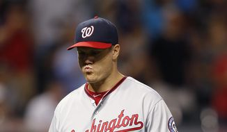 Washington Nationals relief pitcher Jonathan Papelbon walks off after being pulled after loading the bases with Cleveland Indians during the ninth inning of a baseball game Tuesday, July 26, 2016, in Cleveland. The Indians won 7-6. (AP Photo/Ron Schwane)