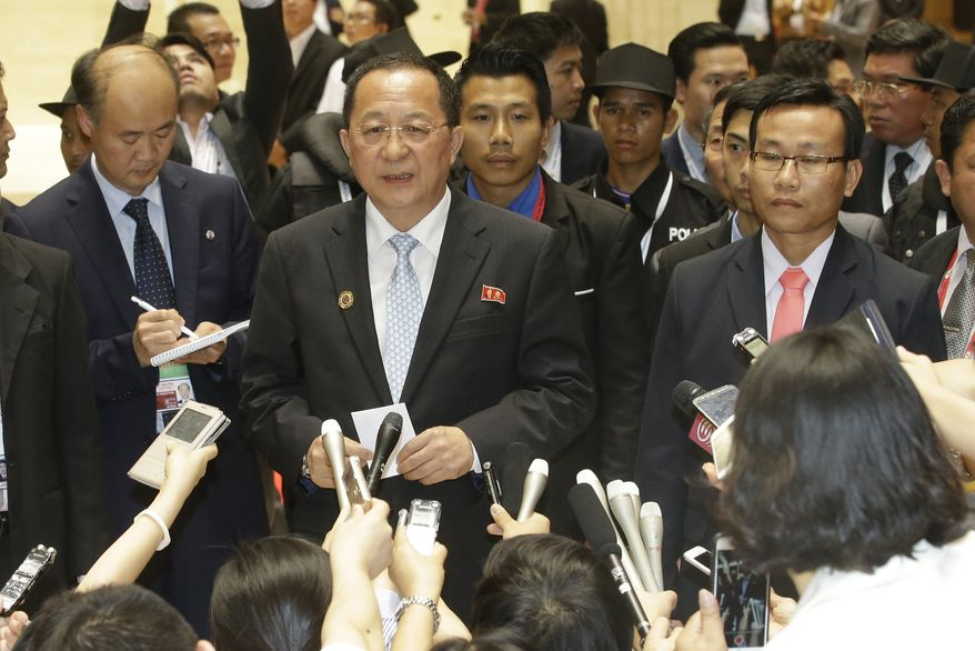 North Korea Foreign Minister Ri Yong Ho talks to a reporter after a break during the 23rd Asean Regional meeting in Vientiane, Laos, Tuesday, July 26, 2016. (AP Photo/Sakchai Lalit)
