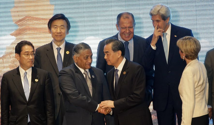 Top left to right; South Korea's Foreign Minister Yun Byung-se, Russia's Foreign Minister Sergey Lavrov, and U.S. Secretary of State John Kerry, stand behind, left to right front; Japan's Foreign Minister Fumio Kishida, India Minister External Foreign Affair general V.K. Singh, China's Foreign Minister Wang Yi, and Australia's Foreign Minister Julie Bishop as they wait for a group photo during the 6th East Asia Summit Foreign Minister's meeting in Vientiane, Laos, Tuesday, July 26, 2016. (AP photo/Sakchai Lalit)