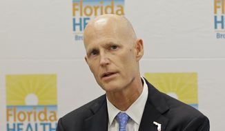 Florida Gov. Rick Scott talks to community leaders at the Broward County Health Department in Fort Lauderdale on July 26, 2016. Scott reiterated the importance of Zika preparedness. The tropical mosquito that carries Zika, Aedes aegypti, likes to live near people and it doesn't travel far. (Associated Press) **FILE**