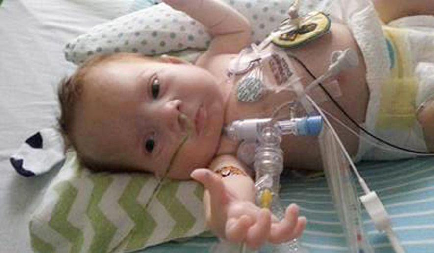 """This 2013 photo provided by Kara McHenry of North Carolina shows her son, Corbin, who lived for four months after his birth in April 2013. Prenatal tests found trisomy 13; doctors recommended an abortion. But she found a support group on Facebook showing happy-looking children learning to walk. She also found a hospital that offered treatment, in Pennsylvania, 400 miles from her home near Greenville, North Carolina. """"I couldn't just give up,"""" McHenry said, so the family temporarily moved north. (Kara McHenry via AP)"""