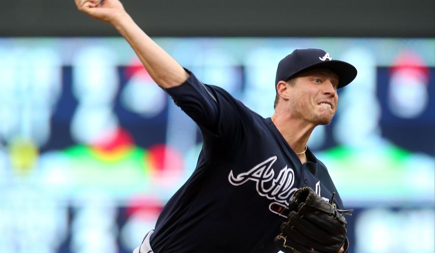 Atlanta Braves pitcher Lucas Harrell throws to a Minnesota Twins batter during the first inning of a baseball game Tuesday, July 26, 2016, in Minneapolis. (AP Photo/Jim Mone)