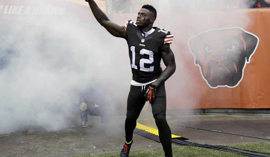 File-This Dec. 14, 2014, file photo shows Cleveland Browns wide receiver Josh Gordon being introduced before an NFL football game against the Cincinnati Bengals in Cleveland. Gordon is expected to miss at least two weeks of training camp with a quadriceps injury, the latest setback for the troubled player. Gordon, who was reinstated on Monday by NFL Commissioner Roger Goodell following a lengthy suspension for drug violations, took a physical on Tuesday, July 26, 2016, and it was determined he will need time to recover from an injury sustained while working out on his own. (AP Photo/Tony Dejak, File)