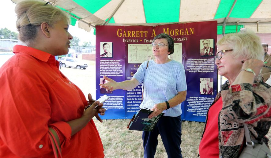 In a Monday, July 25, 2016 photo, Sandra Morgan, left, of Cleveland, granddaughter of Garrett A. Morgan, speaks with descendants of the miners who were killed in a tunnel explosion in 1916 during a ceremony commemorating the 100th anniversary of the 1916 waterworks tunnel disaster held at the Garrett A. Morgan Water Treatment Plant in Cleveland. In center is Karen Altmos of Fairview Park. Her great uncle Clarence Welsh died trying to rescue the workers trapped in the tunnel. On right is Leanne Schwind of Mentor. Her husband's great uncle also perished trying to save the trapped miners.  (Lisa DeJong/The Plain Dealer via AP) /