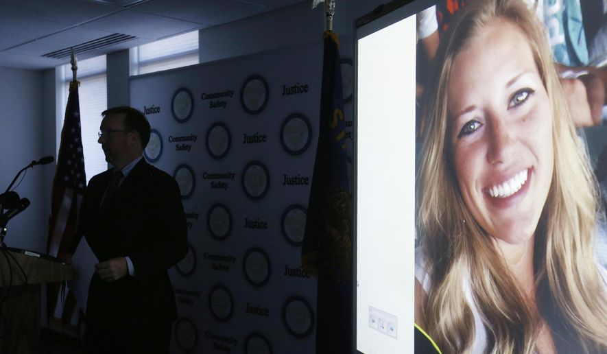 A picture of missing person Kaylee Sawyer is displayed on a screen as Deschutes County District Attorney John Hummel speaks during a press conference on Tuesday, July 26, 2016, at the Deschutes County Courthouse in Bend, Ore. A small Northern California town was rocked by a shooting, kidnapping and carjacking on Tuesday, all allegedly committed by a man and woman from Oregon who led police on a high-speed chase before they were captured. The man, Edwin Lara, was fleeing his home state after being implicated Monday in the disappearance of a 23-year-old. Lara was charged with murder Tuesday in the death of Sawyer, of Bend, Ore. (Joe Kline/The Bulletin via AP)