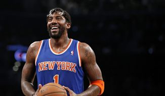 """FILE - In this Dec. 5, 2013, file photo, New York Knicks forward Amare Stoudemire smiles before shooting a free throw during the team's NBA basketball game against the Brooklyn Nets in New York. Stoudemire retired Tuesday, July 26, 2016, after signing a contract with the Knicks with much less fanfare than the $100 million deal he inked six years ago to halt the team's downward spiral. """"Although my career has taken me to other places around the country, my heart had always remained in the Big Apple,"""" he said in a statement. """"Once a Knick, Always a Knick."""" (AP Photo/Kathy Willens, File) **FILE**"""
