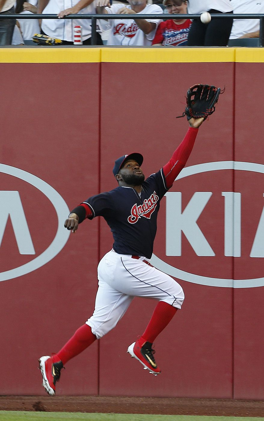 Cleveland Indians' Abraham Almonte makes a leaping catch for the out on Washington Nationals' Bryce Harper during the third inning of a baseball game Tuesday, July 26, 2016, in Cleveland. (AP Photo/Ron Schwane)