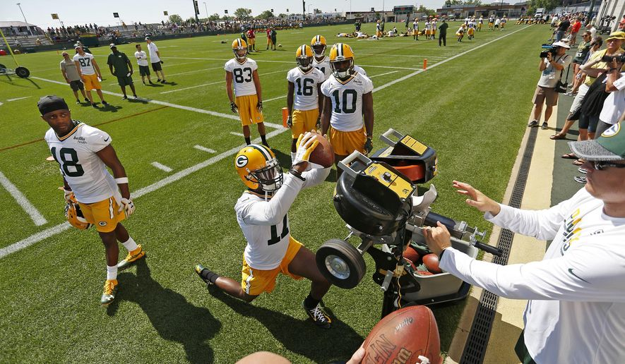 Green Bay Packers wide receiver Davante Adams (17) catches a pass while wide receivers Jamel Johnson (10), Herb Waters (16), Jeff Janis (83) and Randall Cobb (18) watch during NFL football training camp, Tuesday, July 26, 2016, in Green Bay, Wis. (AP Photo/Matt Ludtke)