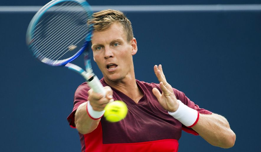 Tomas Berdych of the Czech Republic returns  the ball during a men's second round Rogers Cup tennis action in Toronto on Tuesday, July 26, 2016. (Nathan Denette/The Canadian Press via AP)