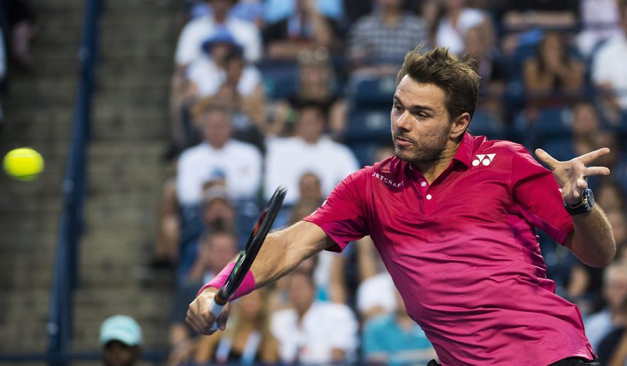 Stan Wawrinka, of Switzerland, returns the ball to Mikhail Youzhny, of Russia, at the Rogers Cup tennis tournament Tuesday, July 26, 2016, in Toronto. (Nathan Denette/The Canadian Press via AP)
