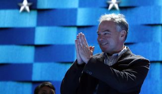 Democratic Vice Presidential candidate, Sen. Tim Kaine, D-Va., looks over the podium as he checks out the stage before the start of the third day session of the Democratic National Convention in Philadelphia, Wednesday, July 27, 2016. (AP Photo/Carolyn Kaster)