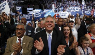Virginia Gov. Terry McAuliffe applauds as Democratic Presidential candidate Hillary Clinton appears on the screen during the second day session of the Democratic National Convention in Philadelphia, Tuesday, July 26, 2016. (AP Photo/Carolyn Kaster)
