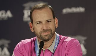 Sergio Garcia smiles as he listens to a question during a news conference before a practice round for the PGA Championship golf tournament at Baltusrol Golf Club in Springfield, N.J., Wednesday, July 27, 2016. (AP Photo/Chuck Burton)