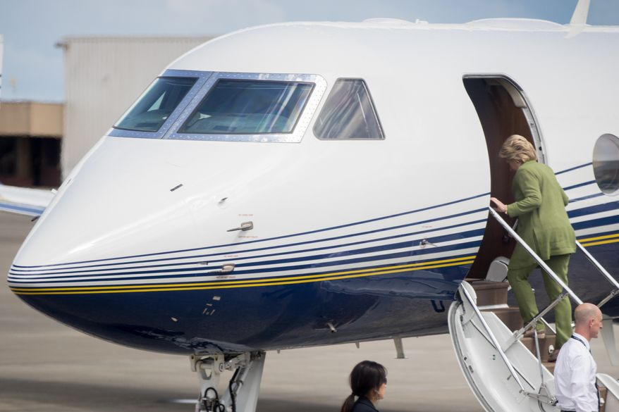 Democratic presidential candidate Hillary Clinton boards a plane in Orlando to attend a rally at the Florida State Fairgrounds in Tampa on Friday. (Associated Press)