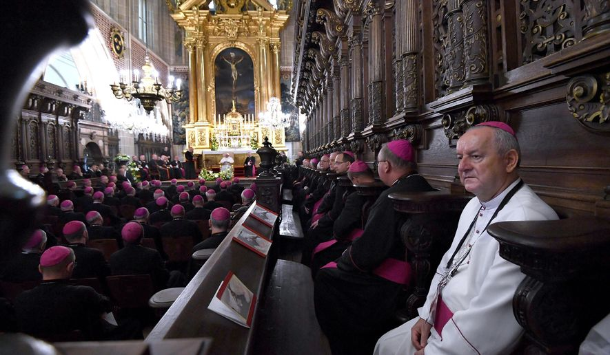 """Pope Francis meets bishops in the Wawel Cathedral in Krakow, Poland, Wednesday, July 27, 2016. Pope Francis has prayed by the relics of the late pope from Poland, St. John Paul II, and has met with Poland's bishops who vowed to """"listen carefully"""" to his teaching. (Daniel Dal Zennaro/Pool Photo via AP)"""