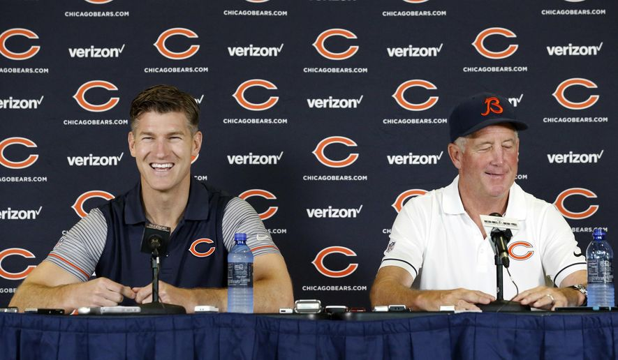 Chicago Bears general manager Ryan Pace, left, and head coach John Fox smile as they listen to a question at a news conference during team's NFL football training camp at Olivet Nazarene University, Wednesday, July 27, 2016, in Bourbonnais, Ill. (AP Photo/Nam Y. Huh)