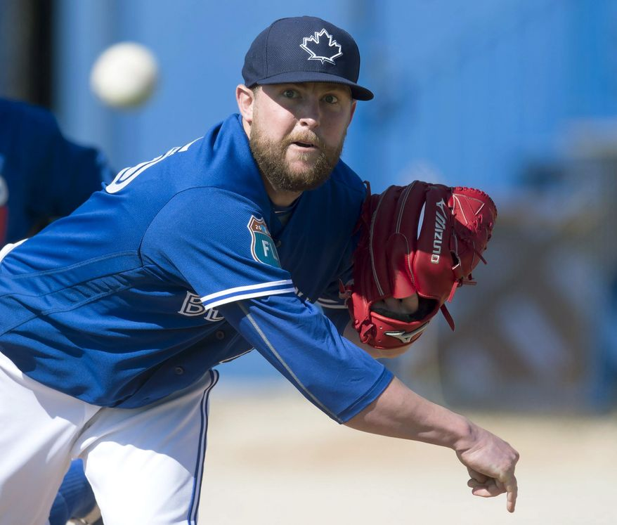 FILE - In this  Feb. 25, 2016, file photo, Toronto Blue Jays pitcher Drew Storen pitches during baseball spring training in Dunedin, Fla. Struggling relief pitcher Storen had been designated for assignment by the Blue Jays. (Frank Gunn /The Canadian Press via AP, File)