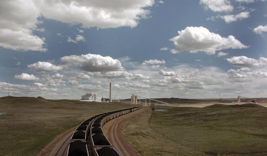 FILE - In this Thursday, April 29, 2010 file photo, a pair of coal trains idle on the tracks near Dry Fork Station, a coal-fired power plant being built by the Basin Electric Power Cooperative near Gillette, Wyo. Teams from Canada, China, Finland, India, Scotland, Switzerland and the U.S. have submitted 47 proposals for the first round of a $20 million contest to put power-plant emissions to profitable use, NRG COSIA Carbon XPRIZE officials announced Wednesday, July 27, 2016. (AP Photo/Matthew Brown, File)