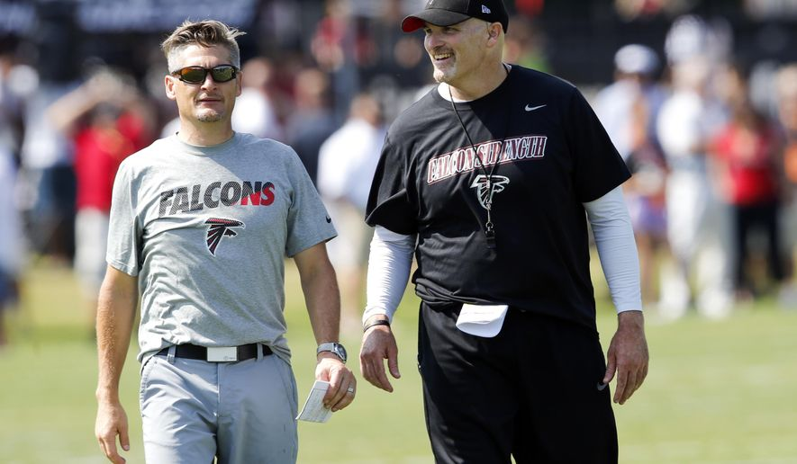 FILE - In this July 31, 2015, file photo, Atlanta Falcons head coach Dan Quinn, right, talks with general manager Thomas Dimitroff during an NFL football training camp in Flowery Branch, Ga. The Falcons were 8-8 in Quinn's first season. (AP Photo/John Bazemore, File)