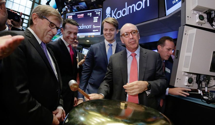 Kadmon Holdings President & CEO Harlan Waksal, right, rings a ceremonial bell to mark the beginning of trading of his company's IPO, on the floor of the New York Stock Exchange, Wednesday, July 27, 2016. He is joined by company officials, including CFO Konstantin Poukalov, second from right. (AP Photo/Richard Drew)