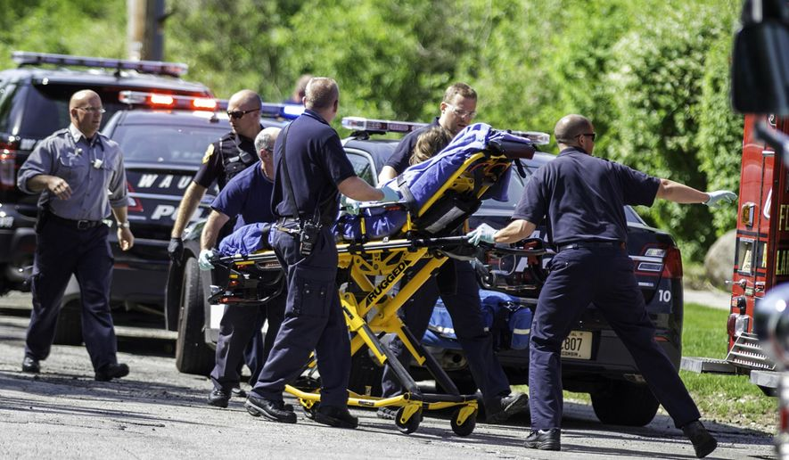 FILE - In this May 31, 2014 file photo, rescue workers take 12-year-old stabbing victim Payton Leutner to an ambulance in Waukesha, Wis. A Wisconsin state appeals court ruled July 27, 2016, that the two girls accused of trying to kill Leutner in an attempt to please the fictional horror character Slender Man should be tried as adults. The 2nd District Appeals court, in a pair of rulings, affirmed a lower court's determination that it was reasonable to try both girls as adults. The girls could appeal the rulings to the Wisconsin Supreme Court. (AP Photo/Abe Van Dyke, File)