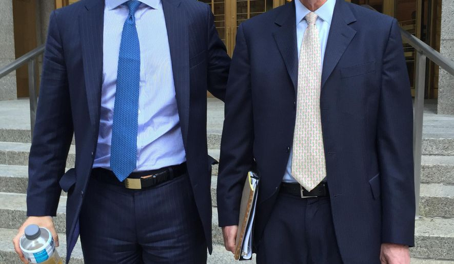 Sean Stewart, left, leaves Manhattan federal court with his lawyer, Mark Gombiner, after opening statements in Stewart's insider trading trial, Wednesday, July 27, 2016 in New York. Gombiner told jurors that his client's father betrayed his son by making over $1 million in illegal profits on trades based on secrets Stewart revealed in confidence about his job as an investment banker. (AP Photo/Larry Neumeister)