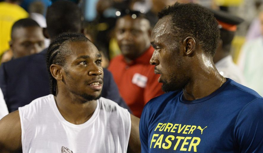 FILE - In this June 11, 2016, file photo, Usain Bolt, right, of Jamaica, speaks with compatriot Yohan Blake after the 100-meter final at the Racers Grand Prix track and field event at the National Stadium in Kingston, Jamaica. The most dominant runner at Jamaica's national track and field championships this summer was not a superstar sprinter like Usain Bolt, Yohan Blake or Veronica Campbell-Brown. It was Kemoy Campbell. (AP Photo/Collin Reid, File)