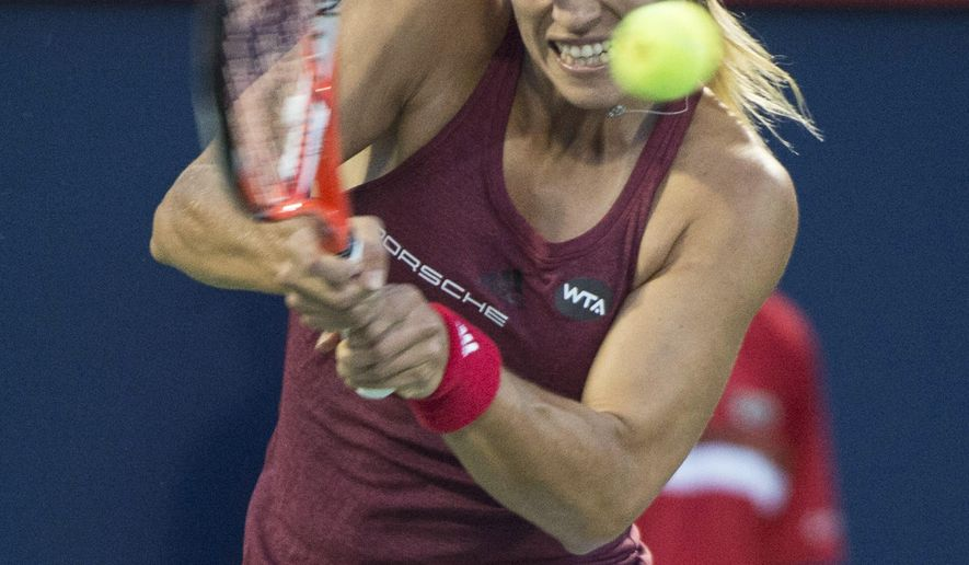 Angelique Kerber, of Germany, returns to Mirjana Lucic-Baroni, of Croatia, at the Rogers Cup tennis tournament Wednesday, July 27, 2016, in Montreal. (Paul Chiasson/The Canadian Press via AP)