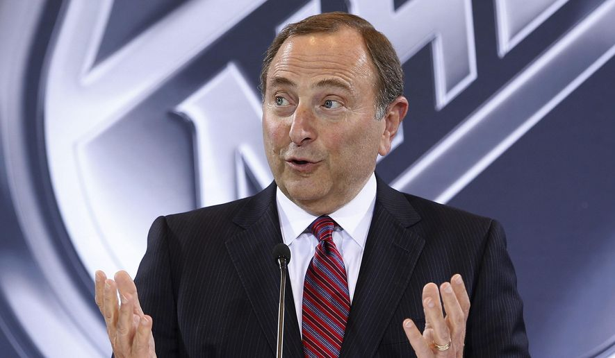 FILE - In this June 22, 2016, file photo, NHL Commissioner Gary Bettman speaks during a news conference in Las Vegas. Bettman's reluctance to link hits to the head in hockey with a degenerative brain disease found in several deceased former players has reached Congress. (AP Photo/John Locher, File) **FILE**
