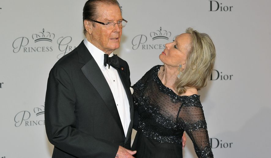 FILE - In this Sept.5, 2015, file photo, actor Roger Moore, left, and his wife Kristina Tholstrup pose on the red carpet as they arrive at the Monaco palace to attend the Princess Grace Foundation gala in Monaco. Moore announced the death of Tholstrup's daughter, Christina Knudsen, on social media and his official website Tuesday, July 26, 2016. (AP Photo/Christian Alminana, File)